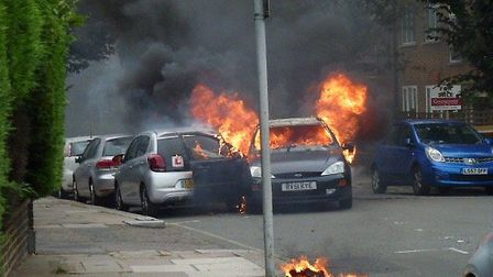 A car was on fire in the middle of the day. Photo: Trevor Arnold