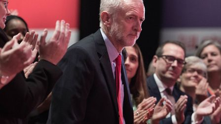 Labour leader Jeremy Corbyn is congratulated after the announcement of his election victory in Liver