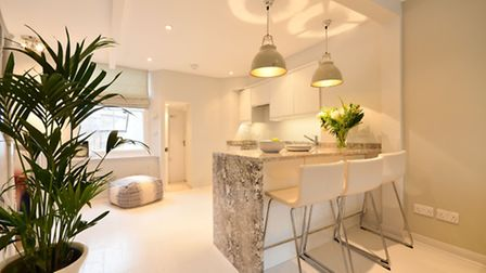 The marble clad breakfast bar is a nice touch in this Hampstead rental