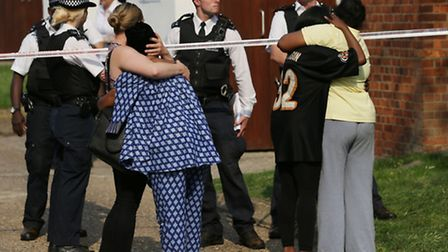 The families gather to grieve. Photo: PA