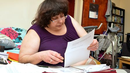 Donna, pictured reading a letter from the DWP, has been given months to live (Picture: Polly Hancock