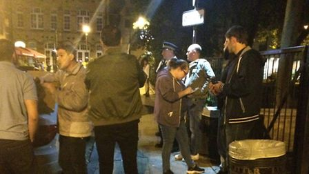 Laughing gas is seized in Hoxton Square from men who were sitting in a car. (Photo: Emma Bartholomew