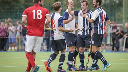 Matt Guise-Brown (second from right) celebrates with his new team-mates. Pic Mark Clews