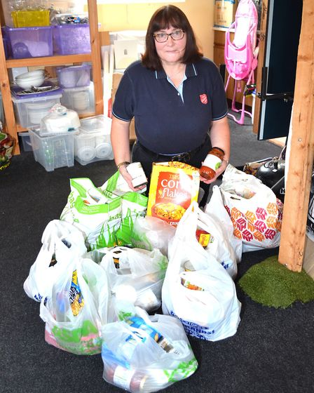 A volunteer at the Salvation Army Citadel in Lowestoft, which is continuing to distribute food to th