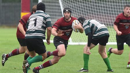 Will Jones (centre) touched down twice for UCS Old Boys in Saturday's friendly against Hendon. Pic: