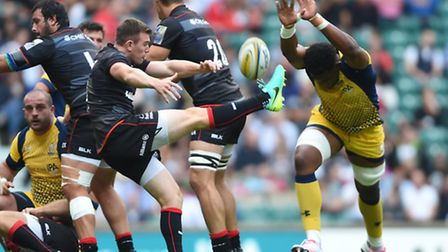 Saracens' Sean Maitland, who scored two tries against Exeter, clears the ball under pressure. Pic: P