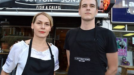 Staff members Ioana Santa and Martin Gomes-Leal general manager outside Sutton and Sons Fish & Chip