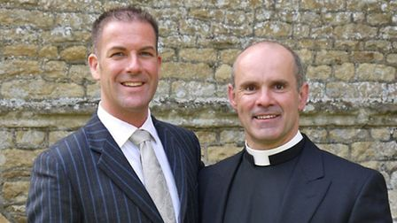 Father Andrew Cain with fiance Stephen Foreshew