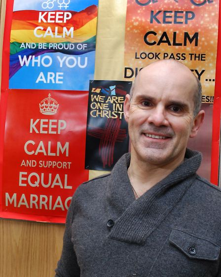 Father Andrew Cain has put up 'Keep clam and support equal marriage' posters after condemning the An