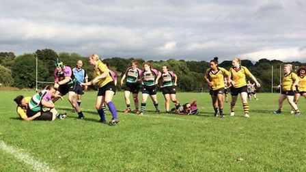 Hampstead Ladies (in yellow) in action against High Wycombe