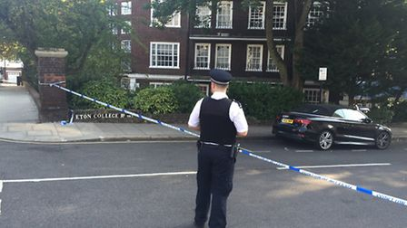 A police cordon around the block of flats in Eton College Road. picture: Emily Banks.