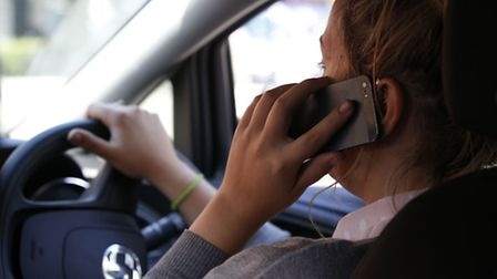 Driver on a mobile call behind the wheel