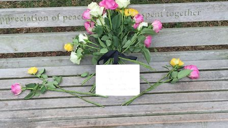 Flowers were laid on the bench where Sheila used to sit