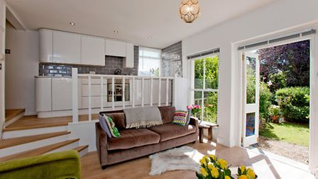 Split levels help demark the living room and a galley kitchen in this West Hampstead home
