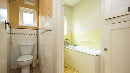 Lemon yellow linoleum and matching tiles are one of the many fabulous colour schemes in this untouch
