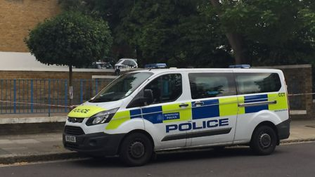 A police cordon at the scene where two men were stabbed on Wednesday night