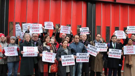 Firefighters and neighbours protest outside Kingsland Fire Station on its last day in 2014. The fire