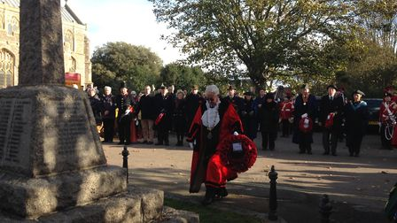 Southwold Town Council watches on as Southwold Town Mayor, Matthew Horwood, lays the council wreath.