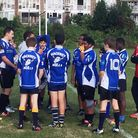 A group of Hackney Bulls players take instructions from their coach