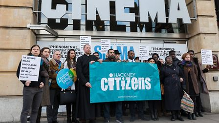 The Hackney Citizens community group take part in a protest to campaign for the living wage, outside