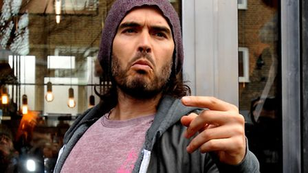 Russell Brand makes a speech as he arrives to open the Trew Era Cafe on the New Era estate, Hoxton (