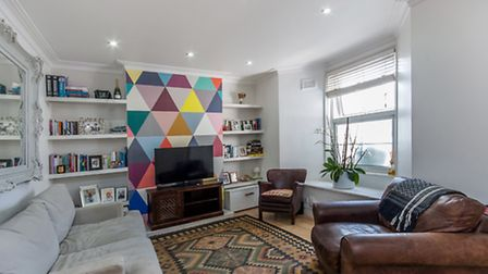 You can't help but smile at the cheerful accent walls in this Kentish Town home