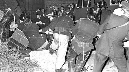 Fire crews at the scene in Goswell Road on September 29th 1969 use their bare hands to try and rescu
