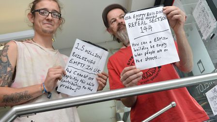 Rich and Ned with some of the window notices they have posted at 20 Westland Place