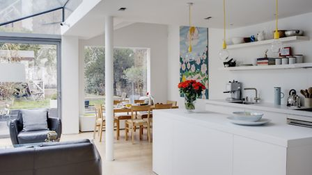 By knocking through the partition walls they created a large living space for the whole family, Phot