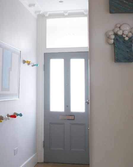 The door is the same pale grey as their old home in Hackney, as per their children's request. Photo