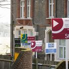 Sold, To Let and Let By estate agent signs placed outside