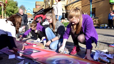 Youngsters take part in a graffiti art workshop during the Flipside Festival in Lowestoft. Picture: