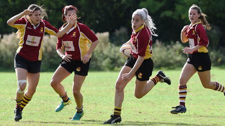 Micha Palmer (centre) crossed the line on her return from injury. Pic: Paolo Minoli