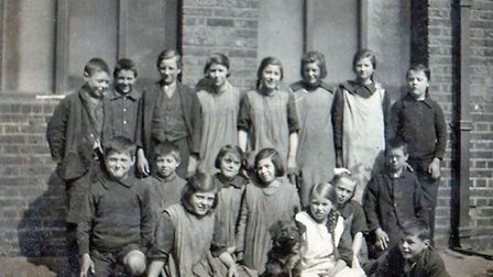 Children with Brownie the dog. c. 1924