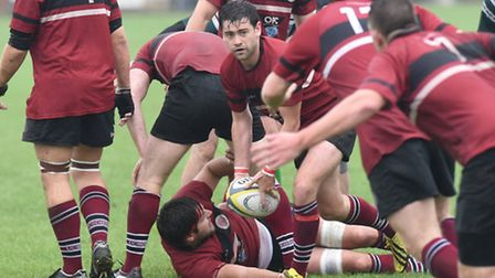 Nathaniel Breakwell (centre) in action for UCS Old Boys. Pic: Paolo Minoli