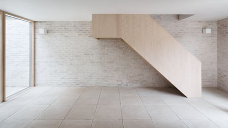 The floating staircase is made of Douglas fir that has been treated with white oil. Photo credit: Ro
