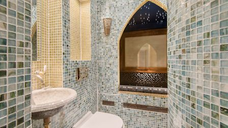 There's a bling moments in the mosaiced spa/bathroom