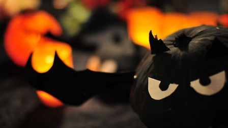 Paint one black and add wings for a spooktacular flock of bat-kins. Photo credit: Flickr / Zen Whisk