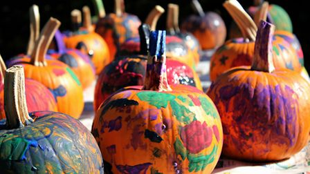 Painting pumpkins works for all ages: younger children can create works of abstract pumpkin art. Pho