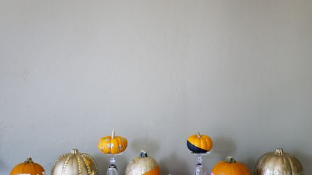 Opt for directional slashes of bright paint or go all out with a full glitter pumpkin. Photo credit: