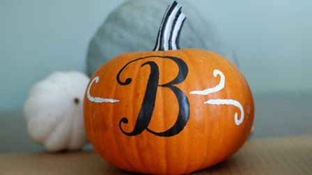 A family of monogrammed pumpkins would make for an elegant display. Photo credit: Flickr / Justin Sn