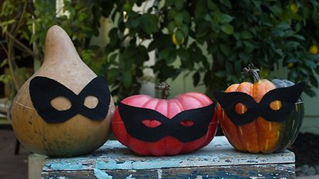 Craft some simple paper masks for a quick and easy pumpkin masquerade. Photo credit: Flickr / Andiez
