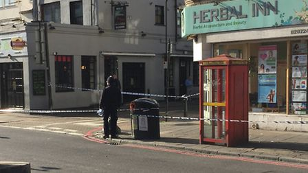 Balls Pond Road is taped off at the junction with Kingsland Road. Picture: Dominic Sutton