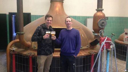 Pete and brewer Thomas toast in front of the brew-kettle of Forest Road's first batch of beer