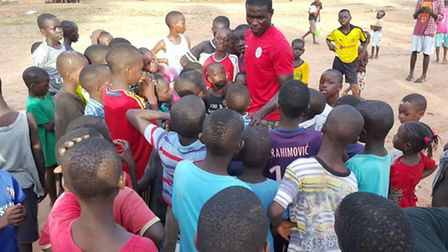Priory Park coach Saidou Jarju meets a group of youngsters in his home town of Ziguinchor