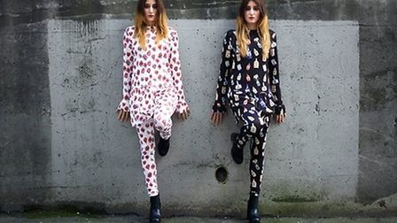 Designer twins Nadia and Zehra wearing their own fashion creations