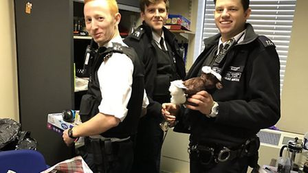 Officers at Stoke Newington Police Station sort through the toy donations for children in care