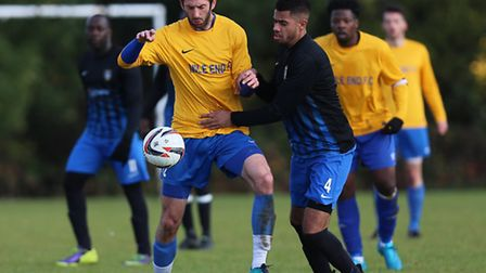 Mile End (in yellow and blue) in action against FC Bartlett in the Premier Division. Picture: Gavin