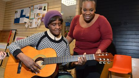 Tanisha (left) joins the over 50s Guitar drop in session at Wayside Community Centre, Lower Clapton,