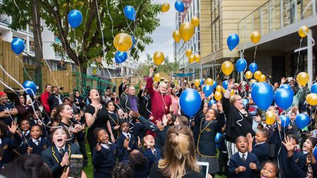 Bishop of London, Richard Chartres and children at the opening of their new school building. Picture